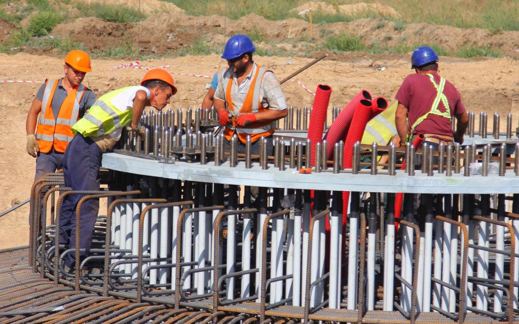 Workers preparing concrete reinforcement